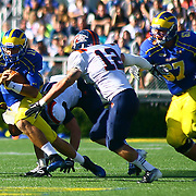 Delaware quarter back Trent Hurley #12 scrambled towards the sidelines during a Week 3 NCAA football game against Bucknell University...#13 Delaware defeated The Bison of Bucknell 28 -17 at Delaware Stadium Saturday Sept. 15, 2012 in Newark Delaware.