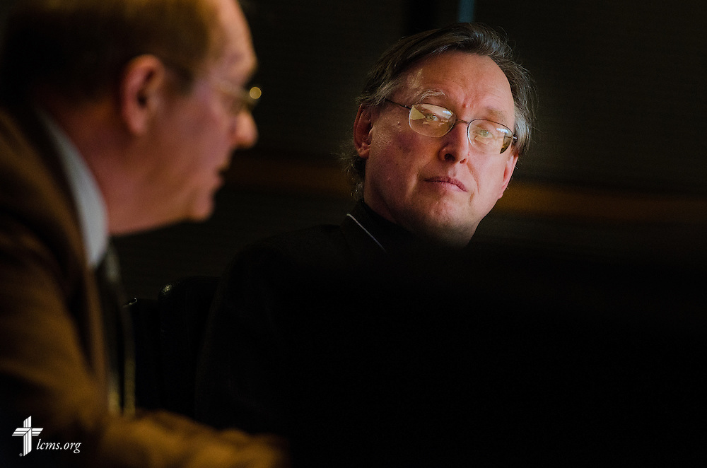 """Dr. Reinhard Hütter of Duke Divinity School listens as the Rev. Dr. William Weinrich (left), professor at Concordia Theological Seminary in Fort Wayne, Ind., presents during a """"Think Tank"""" of representatives from Concordia University Schools, boards, and others at the International Center of The Lutheran Church--Missouri Synod on Monday, March 31, 2014, in Kirkwood, Mo. LCMS Communications/Erik M. Lunsford"""