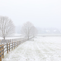 Snow covered farmland in Sherborn Massachusetts during a New England winter snowstorm.<br />