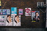 every day Street scene in Japan. Posters on a wall