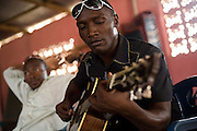 Members of the band King's Jubilee, Francis Wesseh (left) and Terry Williams (right) during a jamming session at the Buduburam refugee settlement, roughly 20 km west of Ghana's capital Accra on Friday April 13, 2007. The group, which is composed of five Liberian men living at Buduburam, is currently recording their second album, and already has a growing number of fans back in Liberia. The Buduburam refugee settlement is still home over 30,000 Liberians, most of which have mixed feelings about returning to Liberia..