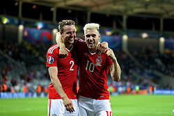 TOULOUSE, FRANCE - Monday, June 20, 2016: Wales' Chris Gunter and Aaron Ramsey celebrate the 3-0 victory over Russia and qualification for the knock-out stage during the final Group B UEFA Euro 2016 Championship match at Stadium de Toulouse. (Pic by David Rawcliffe/Propaganda)