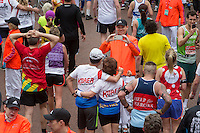 The mass of runners head up The Mall after finishing the Virgin Money London Marathon, Sunday 26th April 2015.<br /> <br /> Dillon Bryden for Virgin Money London Marathon<br /> <br /> For more information please contact Penny Dain at pennyd@london-marathon.co.uk