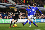 Ipswich Town defender Adam Webster (6) slides in to tackle Leeds United midfielder Eunan O'Kane (14) during the EFL Sky Bet Championship match between Ipswich Town and Leeds United at Portman Road, Ipswich, England on 13 January 2018. Photo by Dennis Goodwin.