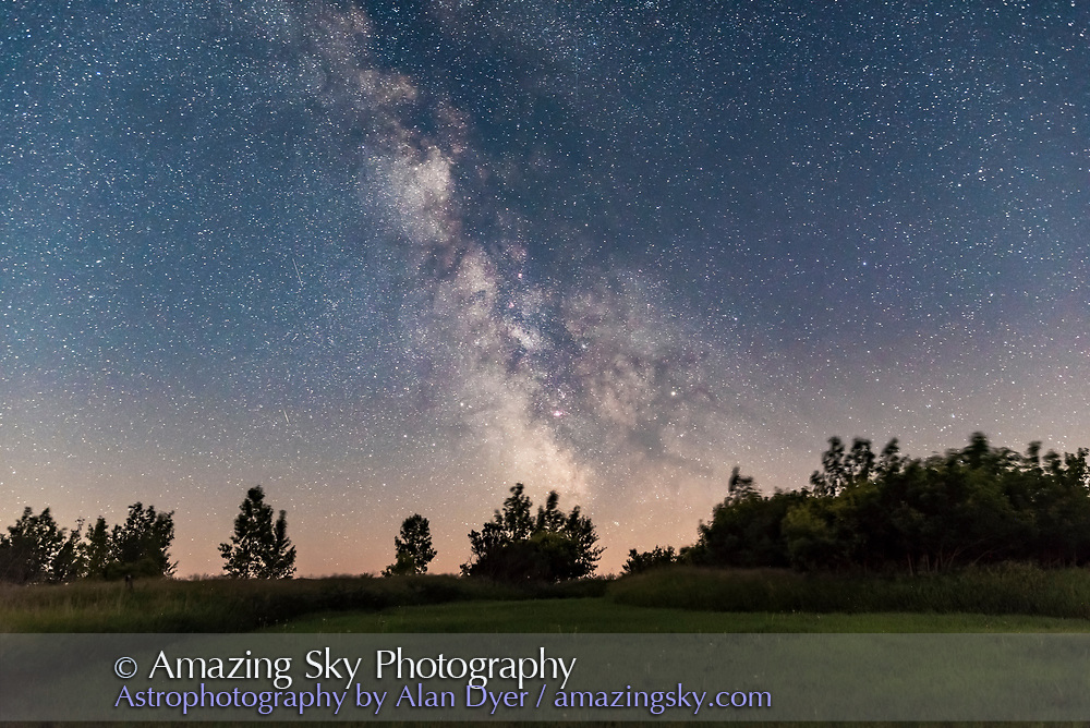 The summer Milky Way from my backyard on a very clear July evening just before moonrise, taken as an example of a fixed camera shot, no tracking, in a 20 second exposure at f/2.5 and ISO 3200 with the Sigma 24mm lens and Nikon D750. <br /> <br /> Saturn is set into the Dark Horse area of the Milky Way, at right of centre. <br /> <br /> The ground is a stack of 5 exposures, the ground is from one exposure.