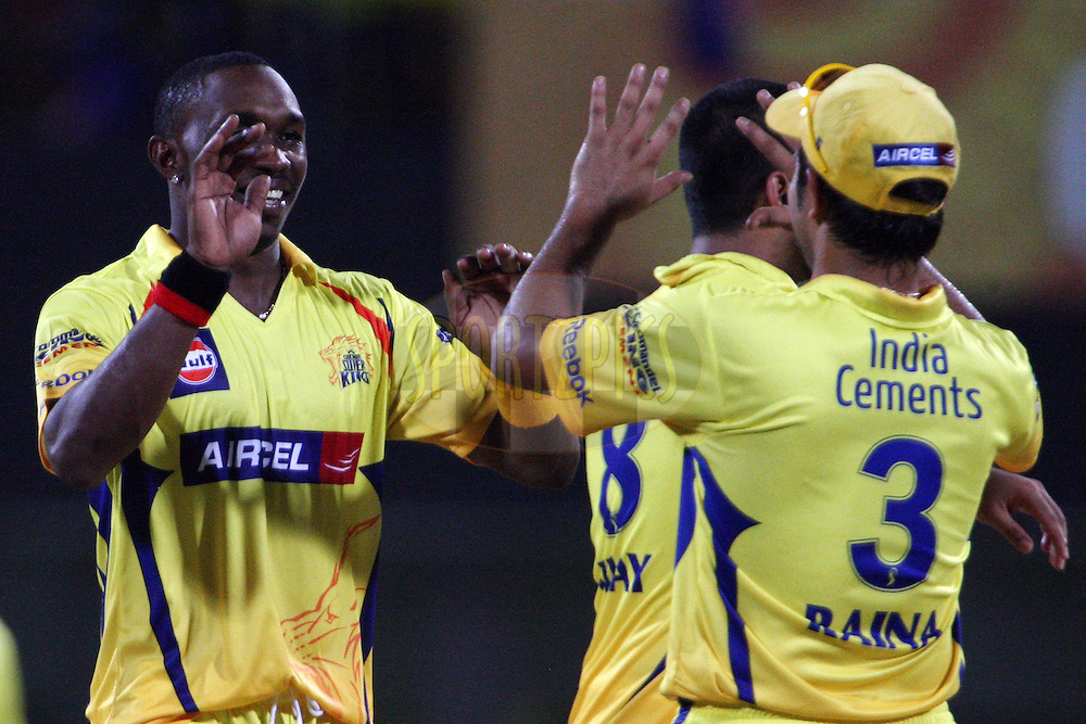 Suresh Raina congratulates Dwayne Bravo on taking a wicket during match 56 of the Indian Premier League ( IPL ) Season 4 between the Chennai Superkings and The Delhi Daredevils held at the MA Chidambaram Stadium in Chennai, Tamil Nadu, India on the 12th May 2011..Photo by Jacques Rossouw/BCCI/SPORTZPICS