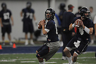 Quarterbacks Nathan Stanley (12) and Zack Stoudt (8) go through drills during Ole Miss' spring practice at the IPF in Oxford, Miss. on Monday, March 28, 2011.