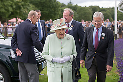 Queen Elizabeth II and the Duke of Edinburgh arrive for the Bentley Motors Royal Windsor Cup Final at Guards Polo Club, Windsor Great Park, Egham, Berkshire.