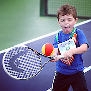 March 1, 2014, Palm Springs, California: <br /> A boy plays tennis during Kids Day at the Indian Wells Tennis Garden sponsored by the Coachella Valley National Junior Tennis and Learning Network.<br /> (Photo by Billie Weiss/BNP Paribas Open)