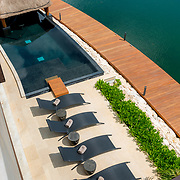 Casa Roberto De La Peña. Puerto Cancun. Photo by: Victor Elias Photography.