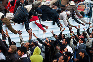 Crowds cheer as people fleeing the violence in Brega arrive in Ajdabiya on March 2, 2011.