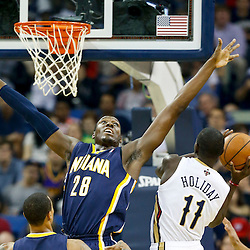Oct 30, 2013; New Orleans, LA, USA; New Orleans Pelicans point guard Jrue Holiday (11) shoots over Indiana Pacers center Ian Mahinmi (28) during the first half of a game at New Orleans Arena. Mandatory Credit: Derick E. Hingle-USA TODAY Sports