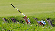 pga13, lynn, spt, 4.-Rickie Fowler hands his club to his caddie from deep in a sand trap on the 11th hole during the first round of the PGA Championship at Whistling Straits in Haven Wi Thursday August 12, 2010.  Photo by Tom Lynn/TLYNN@JOURNALSENTINEL.COM