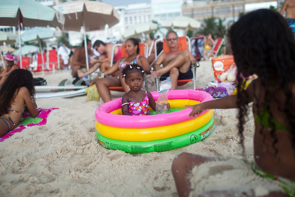 Beach-goers enjoy Posto 9, in Ipanema Beach, Rio de Janeiro, Brazil, Sunday, Feb. 3, 2013.