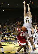 19 February 2009: Wisconsin forward Anya Covington (40) tries to put up a shot around Iowa center Megan Skouby (44) during the second half of an NCAA women's college basketball game Thursday, February 19, 2009, at Carver-Hawkeye Arena in Iowa City, Iowa. Iowa defeated Wisconsin 72-65.