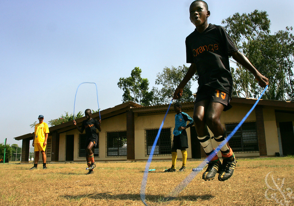 Teenage Ivorian football players take part in drills during an intensive morning training session at the ASEC football academy February 16, 2006 in Abidjan, Ivory Coast. ASEC academy has an established history of producing top notch footballers who go on to play in the top European football leagues.