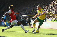 Picture by Paul Chesterton/Focus Images Ltd.  07904 640267.19/11/11.Alex Song of Arsenal and Steve Morison of Norwich in action during the Barclays Premier League match at Carrow Road stadium, Norwich.