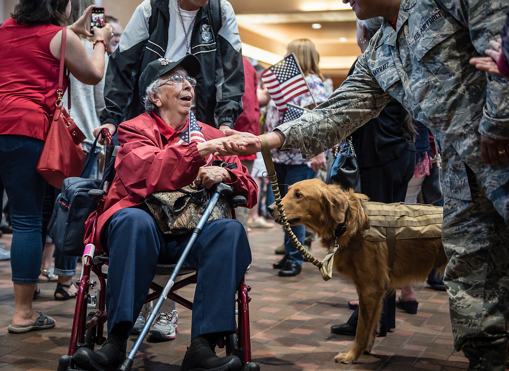 rer060217a/metro/June 02, 2017/Albuquerque Journal<br /> Crucita Simpson(Cq) seen here being greeted by an Air Foce serviceman was one of 23 veterans who returned from  3-day  Honor Flight trip to Washington, D.C. .where they visited the WWII memorial and saw the changing of the guard at Arlington National Cemetery. Mrs. Simpson who lives in Rio Rancho served in the Korean War in a control tower where she guided pilots where to land. The Honor Flight returned to the Sunport Friday afternoon where a couple of hundred folks were present to welcome them. <br /> <br /> <br /> Roberto E. Rosales/Albuquerque Journal