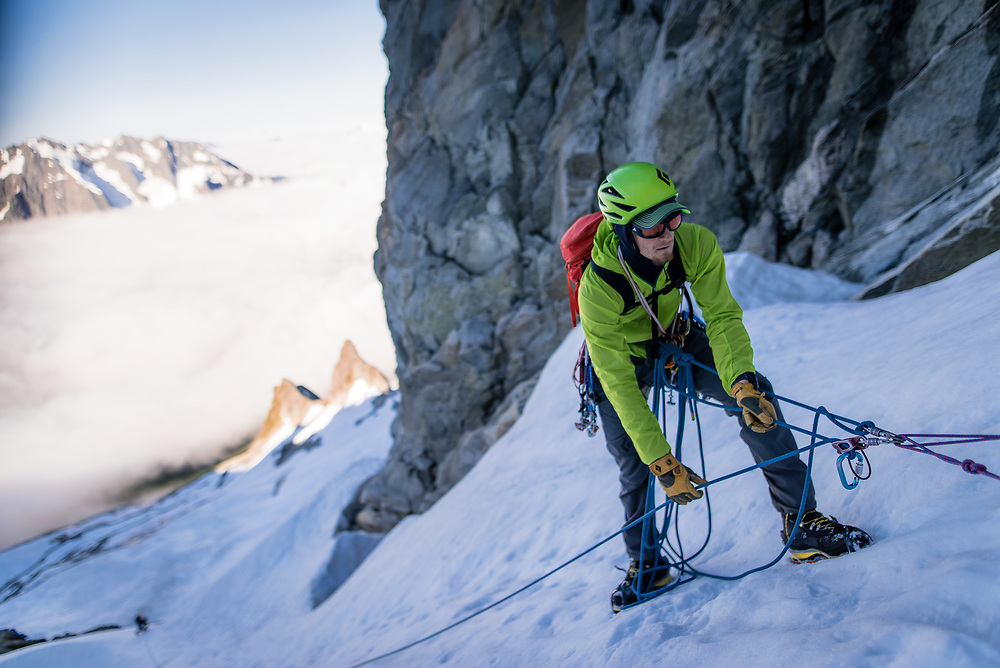 Zak belaying his client Jason on the first pitch in the couloir on Forbidden Peak