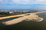 Nederland, Zuid-Holland, Gemeente Westland, 23-05-2011; Delflandse Kust ter hoogte van Ter Heijde en Monster, kassengebied van het Westland op het tweede plan..Zandmotor, aanleg van kunstmatig schiereiland door het opspuiten van zand voor de kust. Wind, golven en stroming zullen het zand langs de kust verspreiden waardoor breder stranden en duinen ontstaan. De zandmotor is een experiment in het kader van kustonderhoud en kustverdediging. In de achtergrond de kassen van het Westland..Sand Engine, construction of artificial peninsula by the raising of sand for the coast of Ter Heijde (near the Hague, at the horizon). Wind, waves and currents will distribute the sand along the coast yielding wider beaches and dunes along the coastline. The Sand Engine is a experiment for coastal maintenance of coastal defense. In the background the Westland greenhouses..luchtfoto (toeslag); aerial photo (additional fee required).foto Siebe Swart / photo Siebe Swart