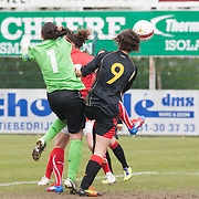 21120413 - HARELBEKE, BELGIUM : Some action happen in front of Belgium's  Nicky Evrard (1) goal during the Second qualifying round of U17 Women Championship between Switzerland and Belgium on Friday April 13th, 2012 in Harelbeke, Belgium.