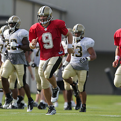31 July 2009: New Orleans Saints quarterback Drew Brees (9) runs with teammates during the opening day of New Orleans Saints training camp held at the team's practice facility in Metairie, Louisiana.
