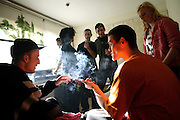 Lee, 26, from West London, (left) and Pete, 23, from Lincolnshire, (right) are smoking while other squatters and friends are chatting in Zil's room inside the Wildwood Road mansion on Sunday, Sep. 30, 2007, in Hampstead, London, England. Situated opposite Hampstead Heath, North London?s green jewel the average price for properties on this road reaches £ 2,500,000. Million Dollar Squatters is a documentary project in the lives of a peculiar group of squatters residing in three multi-million mansions in one of the classiest residential neighbourhoods of London, Hampstead Garden. The squatters' enthusiasm, their constant efforts to look after what has become their home, their ingenuity and adventurous spirit have all inspired me throughout the days and nights spent at their side. Between the fantasy world of exclusive Britain and the reality of squatting in London, I have been a witness to their unique story. While more than 100.000 properties in London still lay empty to this day, squatting provides a valid, and lawful alternative to paying Europe's most expensive rent prices, as well as offering the challenge of an adventurous lifestyle in the capital.