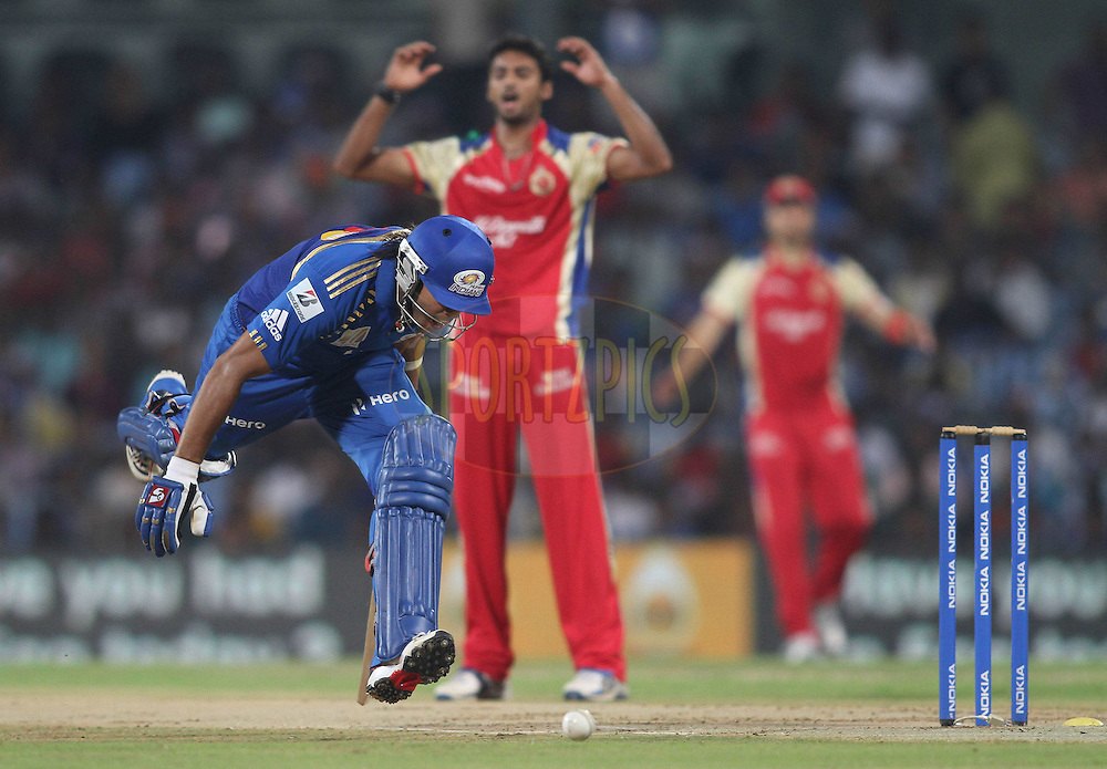 Sarul Kanwar of Mumbai Indians scrambles to make his ground asSreenath Aravind of Royal Challengers Bangalore reacts during the Final of the NOKIA Champions League T20 ( CLT20 ) between The Royal Challengers Bangalore and The Mumbai Indians held at the M. A. Chidambaram Stadium in Chennai , Tamil Nadu, India on the 9th October 2011..Photo by Shaun Roy/BCCI/SPORTZPICS