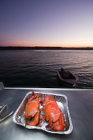 A glorious seafood feast on board the MV Pikkuw of Aurukun Wetland Charters on the west coast of remote Cape York in far north Queensland, Australia.