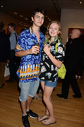 ELLIOTT HORTON-STEPHENS and HANNAH TILSON Ian Dury's niece at a private view of the late Ian Dury's artwork entitled Ian Dury: More Than Fair – Paintings, drawings and artworks, 1961–1972 held at the Royal College of Art, Kensington Gore, London SW7 on 22nd July 2013.