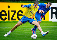 NETHERLANDS, HOENDERLOO : Dutch international football player Kevin Strootman  (l) duel with Luuk de Jong   at the trainingcamp of the Netherlands national football team in Hoenderloo on May 31, 2012. AFP PHOTO/ ROBIN UTRECHT