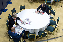 © Licensed to London News Pictures . 29/09/2017 . Torquay , UK . Paul Oakden , Steve Crowther and Gawain Towler reading newspapers in the conference venue . The UK Independence Party Conference at the Riviera International Centre . UKIP is due to announce the winner of a leadership election which has the potential to split the party . Photo credit: Joel Goodman/LNP