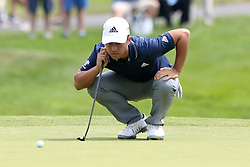 June 22, 2018 - Cromwell, Connecticut, United States - Xander Schauffele lines up a putt on the 8th green during the second round of the Travelers Championship at TPC River Highlands. (Credit Image: © Debby Wong via ZUMA Wire)