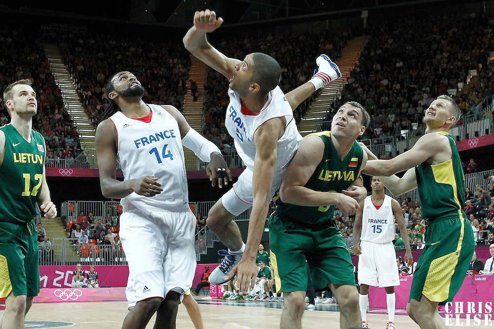 02 August 2012: Nicolas Batum fells down as he misses the dunk over Lithuania Jonas Maciulis during 82-74 Team France victory over Team Lithuania, during the men's basketball preliminary, at the Basketball Arena, in London, Great Britain.