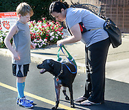 Rachel McCreesh, and her son, Jimmy take their dog Marshall home after his recovery from being hit by a car a week ago Tuesday, September 13, 2016 at CARES in Langhorne, Pennsylvania.  (Photo by William Thomas Cain)