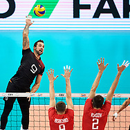 Poland, Krakow - 2017 September 03: (L) Georg Grozer from Germany spikes against Yury Berezhko and Ilia Vlasov both from Russia while final match between Germany and Russia  during Lotto Eurovolleyball Poland 2017 - European Championships in volleyball at Tauron Arena on September 03, 2017 in Krakow, Poland.<br /> <br /> Mandatory credit:<br /> Photo by © Adam Nurkiewicz<br /> <br /> Adam Nurkiewicz declares that he has no rights to the image of people at the photographs of his authorship.<br /> <br /> Picture also available in RAW (NEF) or TIFF format on special request.<br /> <br /> Any editorial, commercial or promotional use requires written permission from the author of image.
