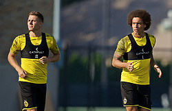 SOUTH BEND, INDIANA, USA - Thursday, July 18, 2019: Borussia Dortmund's Thorgan Hazard (L) and Axel Witsel during a training session ahead of the friendly match against Liverpool at the Notre Dame Stadium on day three of the club's pre-season tour of America. (Pic by David Rawcliffe/Propaganda)