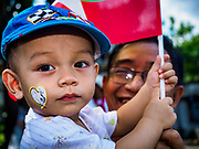 27 NOVEMBER 2017 - YANGON, MYANMAR: A boy with a Pope Francis decal on his cheeks waits to see the Pontiff. Pope Francis arrived in Yangon Monday for a four day / three night visit. Tuesday he is going to the capitol, Naypyidaw (Nay Pyi Taw) to meet with Aung San Suu Kyi and other Myanmar leaders. Wednesday and Thursday he is saying mass in Yangon and on Thursday afternoon he is going to neighboring Bangladesh. There are around 450,000 Catholics in Burma, about 1% of the total population.   PHOTO BY JACK KURTZ