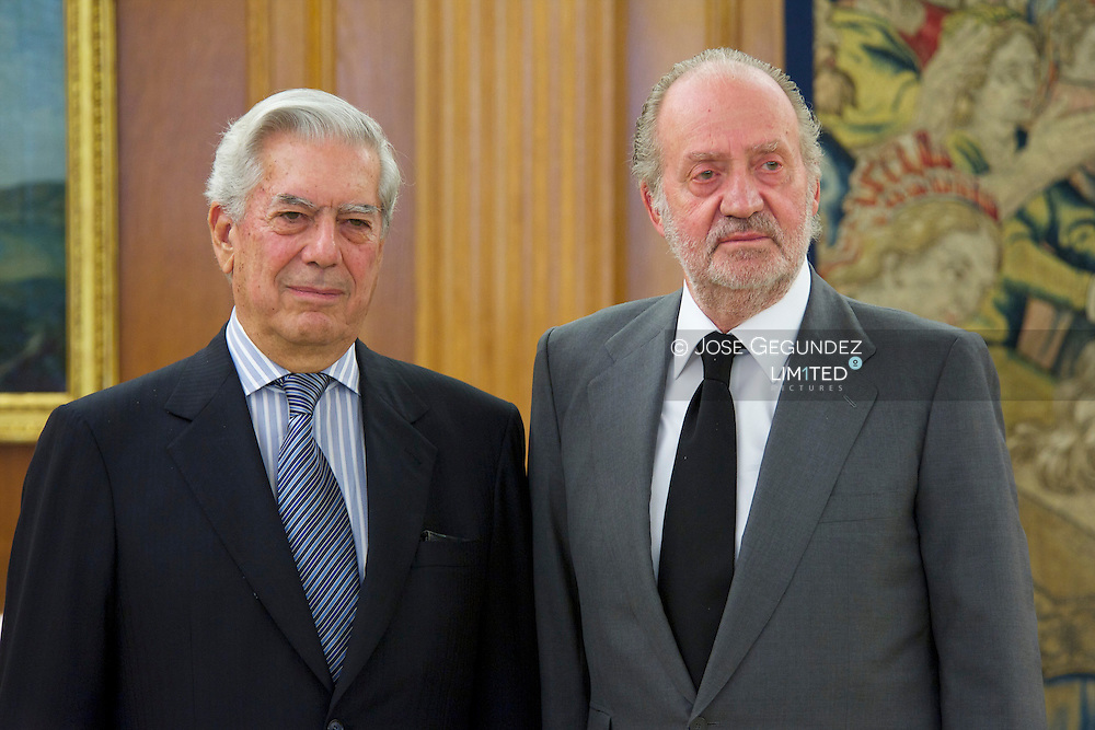 Spanish King Juan Carlos I attends an audience with Peruvian Nobel Prize Mario Vargas Llosa at Zarzuela Palace in Madrid