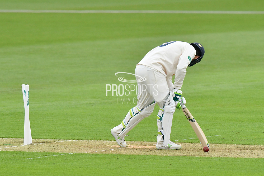 Wicket - Rilee Rossouw of Hampshire loks to the ground after being bowled by Joe Leach of Worcestershire during the Specsavers County Champ Div 1 match between Hampshire County Cricket Club and Worcestershire County Cricket Club at the Ageas Bowl, Southampton, United Kingdom on 13 April 2018. Picture by Graham Hunt.