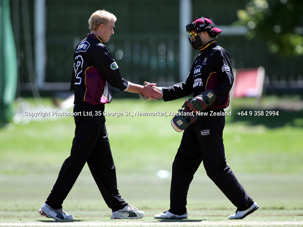 Graeme Aldride is congratulated by masked wicketkeeper Peter McGlashan after bowling Craig McMillan for 124 in the State Shield semi-final between Canterbury and Northern Districts, at the Eden Park Outer Oval, Auckland, on Wednesday 9th February, 2005.<br />PHOTO: Andrew Cornaga/Photosport
