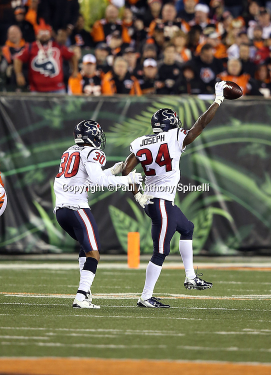 Houston Texans strong safety Kevin Johnson (30) celebrates with Houston Texans cornerback Johnathan Joseph (24) after Joseph intercepts a third quarter pass at the Texans 29 yard line during the 2015 week 10 regular season NFL football game against the Cincinnati Bengals on Monday, Nov. 16, 2015 in Cincinnati. The Texans won the game 10-6. (©Paul Anthony Spinelli)