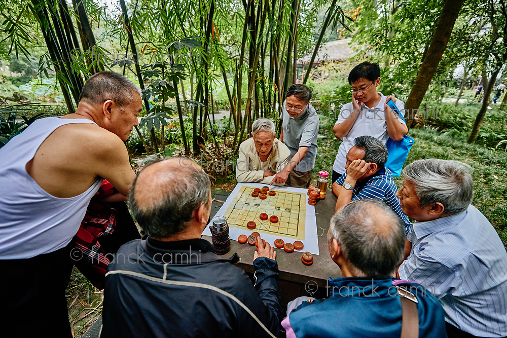 Chengdu, China - September 21, 2014: people playing Xiangqi  chinese chess  Du Fu thatched Cottage park  in Chengdu Sichuan China