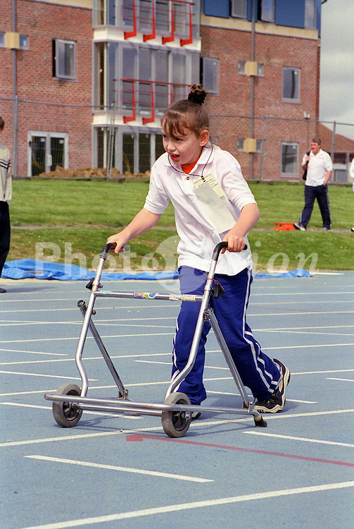 Young girl with disability taking part in Mini games sports event held at Stoke Mandeville Stadium,