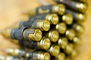 Detail of a chain of bullets for a large caliber machine gun.  Students of the Centurion HEFAT course are introduced to a number of weapons and ballistics to better understand the risk of entering a hostile area. Firearm training for the Hostile Environments and Emeregency First Aid Training course for journalists deploying to war zones in Strausburg, VA.