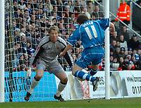 Photo: Ed Godden.<br />Reading v Wolverhampton Wanderers. Coca Cola Championship. 18/03/2006. <br />John Oster shoots for Reading, but is saved by Stefan Postma.