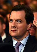 © Licensed to London News Pictures. 03/10/2012. Birmingham, UK Chancellor of the Exchequer, George Osborne, listens to Wiliam Hague's speech on Day 1 at The Conservative Party Conference at the ICC today 7th October 2012. Photo credit : Stephen Simpson/LNP