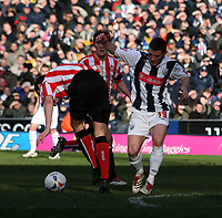 Photo: Mark Stephenson.<br />West Bromwich Albion v Sunderland. Coca Cola Championship. 03/03/2007.<br />West Brom's Jason Koumas skips around the defender