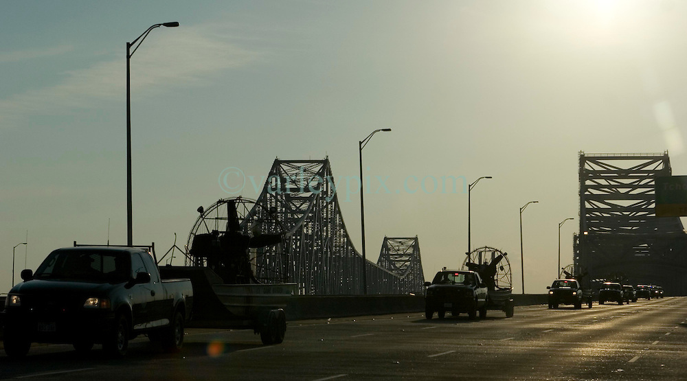 07 Sept 2005. Hurricane Katrina aftermath.<br /> Lines of rescue boats cross the twin span bridge from downtown New Orleans as search and rescue expands to outer lying areas of the city. <br /> Photo; &copy;Charlie Varley/varleypix.com