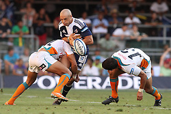CAPE TOWN, SOUTH AFRICA - 5 MARCH 2011, Conrad Jantjes of the Stormers loses the ball forward as Ryno Benjamin of the Cheetahs makes the tackle during the Super Rugby match between DHL Stormers and Cheetahs at DHL Newlands Stadium in Cape Town, South Africa..Photo by Shaun Roy / Sportzpics